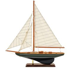 """Nautical accent wood sail boat on stand with canvas sails - Dimensions: 19.69""""H x 3.15""""W x 21.65""""L - Material: Birchwood, Cloth - Shipping: Ships within 5-7 days. US only. - Return: This item is retur"""