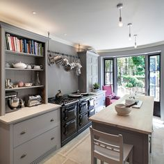 Glamorous narrow dresser in Kitchen Traditional with Hanging Kitchen Cabinets next to Kitchens alongside Black Appliances and Low Basement Ceilings