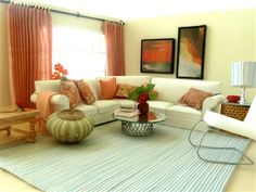 Peach Living Room Ensemble -- This peach living room ensemble includes curtains with rod, 7 pillows, throw, poof, 2 paintings, coffee table with books and flowers, end table with lamp and box,orange orchid, and rug. Product Code: 10056 -- Our Price: $55.00