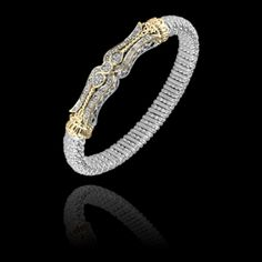 Ladies 14kt yellow gold and sterling silver 8mm Diamond Bangle Bracelet designed by Alwand Vahan containing approximately .24ct total weight of round briliant diamonds. www.dorondiamonds.com