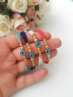 Evil eye bracelet, seed beads bracelet, gold beads bracelet, blue evil eye bracelet, evil eye jewelry, miyuki beads, turquoise bead bracelet Available in 4 different colors; - Turquoise - Dark blue - Red - White This evil eye bracelet is totally handmade. Seed beads & gold