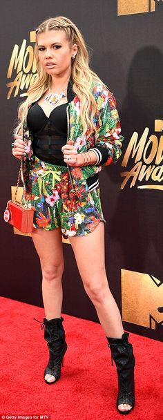 Working it: Host of MTV's Ridiculousness gave it some attitude in a black corset with colourful two-piece
