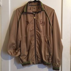 LRG Track Jacket - Men's Size Small Unique LRG track jacket in a men's size small. Tan with green accents and a large beautifully embroidered back. No stains, great condition! I am a women's size small/medium and I wore this as a loose fitting track jacket for myself. If you are a women's large it would probably fit more like a fitted track jacket on you. Check the LRG brand size charts to be sure. LRG Lifted Research Group Jackets & Coats