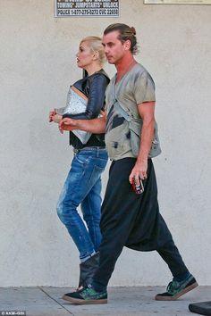 Style star: Gwen showed off her sartorial savvy as she teamed a black top and distressed j...