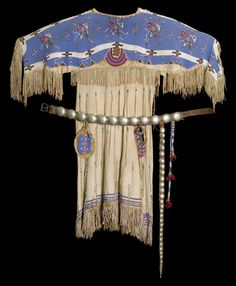 "Lakota dress, c. 1870Buckskin, glass beads, thread    ""…this is a typical dress worn by Plains Indian women. It consists of three assembled parts: the front, the back and the yoke. These three pieces give the garment a T- shape outline.  Very likely this dress was made during the winter months, when the cold forced people to stay inside and work on clothing.  This dress is a good example of the great diligence and talent on the part of the women who made it. It is estimated that it took"