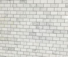 Carrera Marble Beveled Subway Tile Backsplash And Quartz