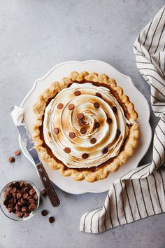 This black-bottom pumpkin pie gets s'mores-ified with its toasted marshmallow topping and chocolate polka dot finish. Pumpkin Pie Recipes, Homemade Cake Recipes, Tart Recipes, Baking Recipes, Sweet Recipes, Dessert Recipes, Desserts, Dessert Ideas, Honey Carrots