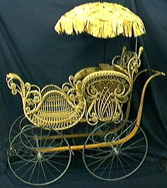 ~ A Wicker Baby Stroller w/ yellow silk sun shade...dating back to The Civil War ~