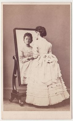 Young woman with mirror, 1870s.