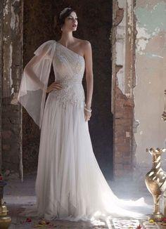 Já tínhamos pensado em fazer uma seleção de vestidos de noiva de um ombro só e, coincidentemente, tivemos uma noiva de um ombro só na semana passada, a Pau