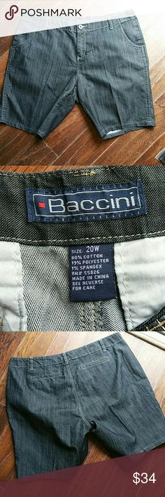 Dark wash trouser styled denim shorts A very nice pair of dark blue / black jean shorts kinda dressy with the trouser styled cut lots of strech for a nice fit Baccini Shorts Bermudas