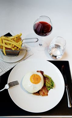 Pan-fried steak à cheval poêléwith pommes frites and an egg at Lazare in Paris. Photo by Oddur Thorisson