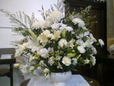 White floral arrangement in church for a memorial service White Floral Arrangements, Flower Arrangements, Memorial Day, Floral Wreath, Wreaths, Memories, Flowers, Plants, Home Decor
