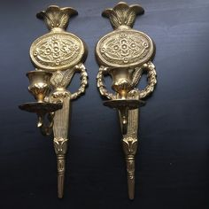 Brass wall sconces / candle holders / fireplace decor https://www.etsy.com/listing/249563736/wall-mounted-candle-holders-vintage