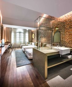 Loke Thye Kee Residences is situated in the heart of Georgetown Penang, one of 5 Malaysian UNESCO world sites rich in heritage. MOD's design draws inspiration from this heritage and specifically the historic Loke Thye. Design Hotel, House Design, Brick Interior, Interior Modern, Interior Ideas, Soho House, Boutique Hotel Room, Boutique Hotels, Casa Hotel