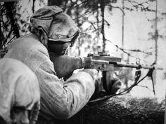 A Finnish soldier with a LS/26 light machine gun, Finland, February, 1940.