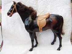 Sindy Horse. Aww. I used to have this, but I wrecked it, pulled his tail out and he had a broken leg too.