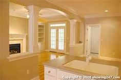 This is identical to my archway solid wall to the left and right of it remove half wall add columns and voila we have a nic open concept living dining and kitchen.