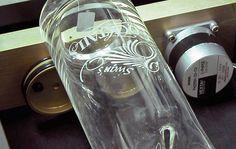 Laser etching a glass vase with an Epilog Laser System.