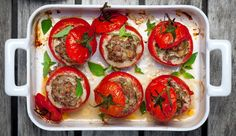 Traditional Italian Stuffed Tomatoes with Sausage and Provolone Cheese (Pomodori Ripieni con Salsiccia e Provolone) | Enjoy this authentic Italian recipe from our kitchen to yours. Buon Appetito!