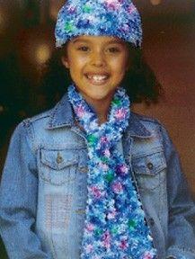Follow this free knit pattern to create a girl's hat and scarf using Bernat Boa eyelash yarn.