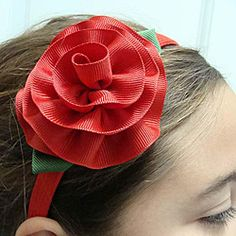 easy and inexpensive hair ornament you can make in any color I love this.  I make one for myself with narrower ribbon and 3 small buds instead of one