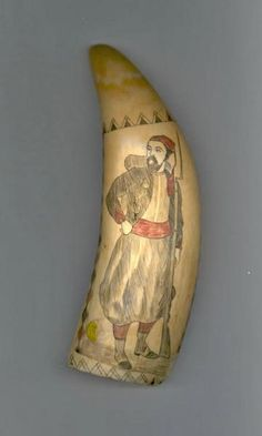 Scrimshaw on whale tooth