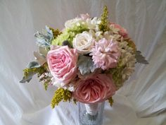 Bride's maid bouquet w/ dusty miller accent, pink roses, and green hydrangeas