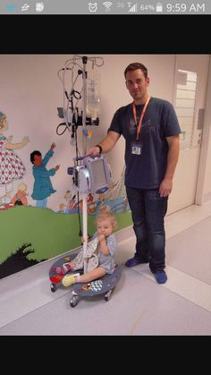"Just what is an IV pole lily pad you ask? The lily pad fits around the base of an IV pole and allows pediatric patients to ""ride"" along with their IV when being transported around the hospital."