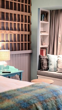 This Modern Irish hotel is set next to the Atlantic Ocean; the interior design combines modern with rustic traditional decor ideas.  While the architecture of the reception is rustic with details found in a country cottage or farmhouse. The natural seaside setting inspires the bedrooms and suites colors.   | #desk | #bed| #windowseat |