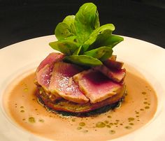Food Plating Idea. Seared Tuna on a mushroom Blini, arugula salad and a gazpacho vinaigrette.