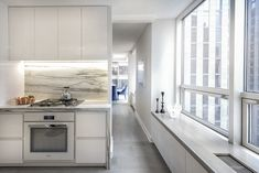 MOMA Tower Residence Kitchen | City views from a sweet, light filled kitchen Light Architecture, Interior Architecture, Interior Design, Upper West Side Apartment, Waterfall Countertop, Modern City, Interior Photography, One Bedroom, Modern Furniture