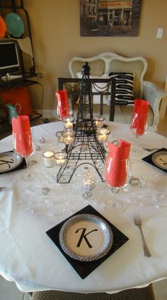 Monogrammed plates for the couple, Eiffel Tower candleholder centerpiece with accents of red, black, and white