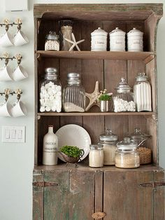 Display kitchen staples like flour, sugar, and grains, in clear jars on open shelves with accessories. Simple and stylish.