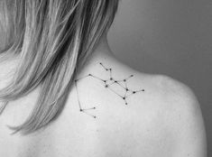 Hand poked Sagittarius constellation tattoo on the right shoulder blade.