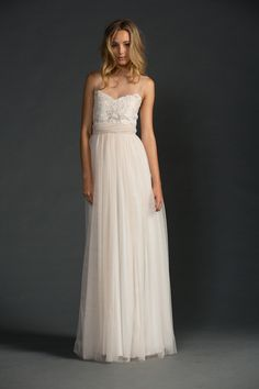 Our Loriel dress embodies sweetness and timeless beauty with an enchanting and unique combination of two-tone nude/ivory Swiss embroidery and nude Italian tulle. Featuring invisible mesh and sweetheart neckline with a romantic soft tulle skirt that falls naturally from the waist accentuated by two tulle 'streams' that fall from the semi-sheer lace back and wraparound …