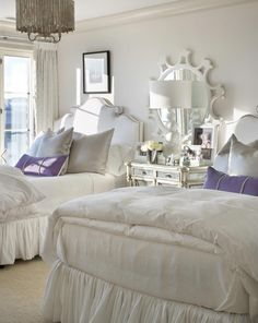 A soft, inviting guest room with purple pop