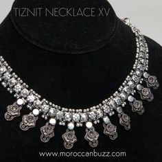 """Chic, with ethnic flair - you'll turn heads with this necklace! Handmade in Tiznit, the """"jewelry capitol"""" of Morocco, this piece uses traditional Berber design elements in an updated style. Approximately 16 inches long x .5 inches wide with .5 inch pendants. Our handmade jewelry may vary slightly from the photo."""