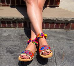 """""""INDIA"""" Our newest handmade Pom Pom / Pearl Greek Leather Sandals are here! Order yours today!!!"""