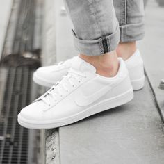 buy popular 6e343 fdd8d plain white nike lace up sneakers, worn by a person, dressed in pale grey  jeans, what is a capsule wardrobe, basic everyday clothes and shoes