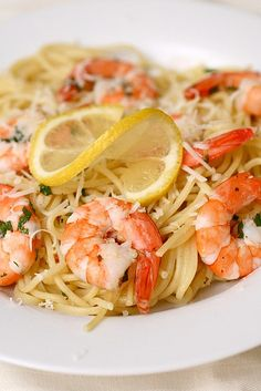 Shrimp Scampi:  3/4 lb. linguine 4 tbsp. unsalted butter 2 tbsp. olive oil 4 cloves minced garlic 1 lb. large shrimp, peeled and deveined 1½ tsp. kosher salt ¼ tsp. pepper 3-4 tbsp. chopped flat leaf parsley Zest of ½ a lemon ¼ cup freshly squeezed lemon juice ¼ lemon, sliced thinly into half-rounds ¼ tsp. red pepper flakes