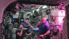 This August 10, 2015 image from NASA TV shows L-R: Japan Aerospace Exploration Agency astronaut Kimiya Yui, with NASA astronauts Kjell Lindgren and Scott Kelly as they eat red romaine lettuce grown on board the International Space Station