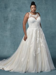 Want to look taller on your big day? An illusion halter neckline is key to elongating your torso. Try this plus-size ball gown wedding dress on for just such an effect.