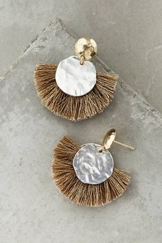 Make everyone stop + stare when you wear these show-stopping rising sun drop tassel stud earrings.