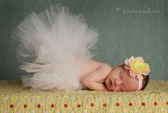 Baby girl in a tutu and headband