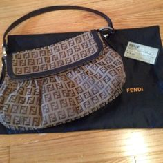 """% Authentic Fendi brown baguette bag % Authentic Fendi Baguette bag. In used conditions. This one is older bag there are no hologram but the serial number and the authenticity card are match to  guarantee %. Come with dust bag. 11x8"""" very roomy and clean in side. FENDI Bags"""