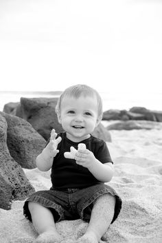 Smiling baby at the beach: