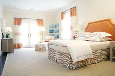 Great bedroom with fab curtains, spots of orange, and brown zebra pattern - Massucco Warner Miller