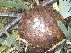 aha something to create from those useless 5c coins! How To Make Gorgeous Garden Art Globes