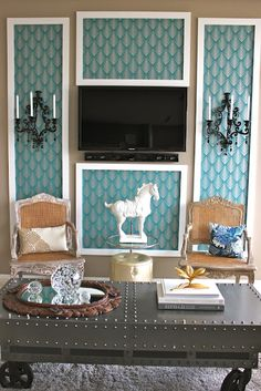 """From previous pinner:  """"@Joanne hung Midnight Wall Sconces on either side of her television."""" -- This might be an interesting way around repainting or using wallpaper..."""